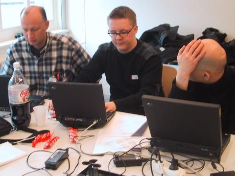 Niels Mache, Heimo Laukkanen and Robert Boulanger talking business
